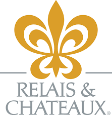 The logo of Relais et Chateaux.